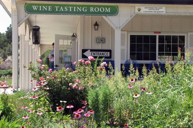 The gardens leading to the Foxfire Farms tasting room are full of flowers and bees.
